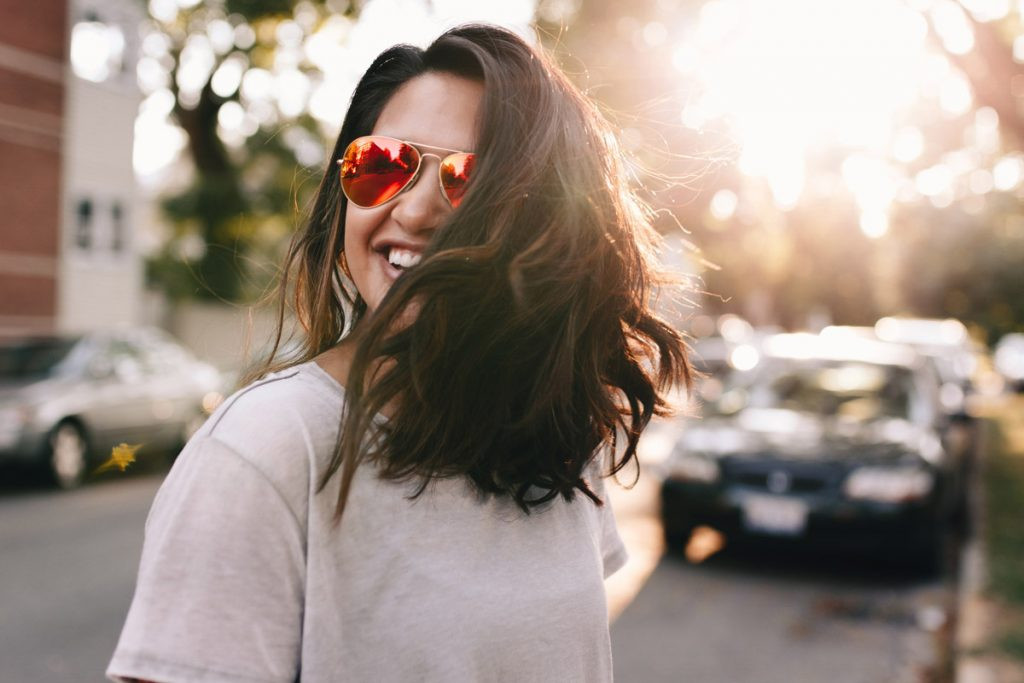 girl smiling with sunnies